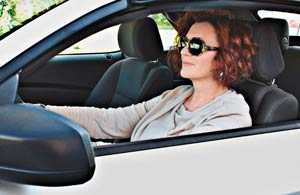 Adult female driver with sunglasses